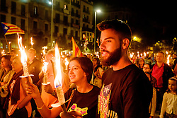 A torchlight procession marks the beginning of the Catalan Weekend celebrations in the Square de les Moreres in Barcelona. This square contains the memorial to those who perished in the 1713-1714 siege of Barcelona.<br /> <br /> (c) Andrew Wilson | Edinburgh Elite media