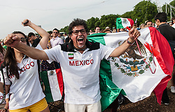 © Licensed to London News Pictures. 11/08/2012. London, UK.  Mexican football fans celebrate after Mexico beat Brazil 2-0 to win the Gold Medal at the Olympic final.  These fans are at BT London Live 2012, Hyde Park, watching the football on large screens.  Photo credit : Richard Isaac/LNP