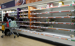 © Licensed to London News Pictures. 01/10/2021. London, UK. A shopper walks past nearly empty shelves of pre cooked meat products in Sainsbury's, north London, amid fears of food supplies shortages over Christmas. UK food producers and supermarkets are warning that shoppers are likely to face product shortages in the coming weeks after thousands of EU nationals quit their jobs as truck drivers in the UK following Brexit. According to the government, 5,000 heavy truck drivers and 5,500 poultry workers will be given working visas until Christmas 2021. Photo credit: Dinendra Haria/LNP