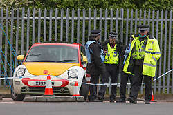 © Licensed to London News Pictures. 22/05/2021. London, UK. Police guard the scene after members of the environmental group Animal Rebellion blocked McDonald's distribution centre in Hampstead Industrial Estate in north London. Photo credit: Marcin Nowak/LNP