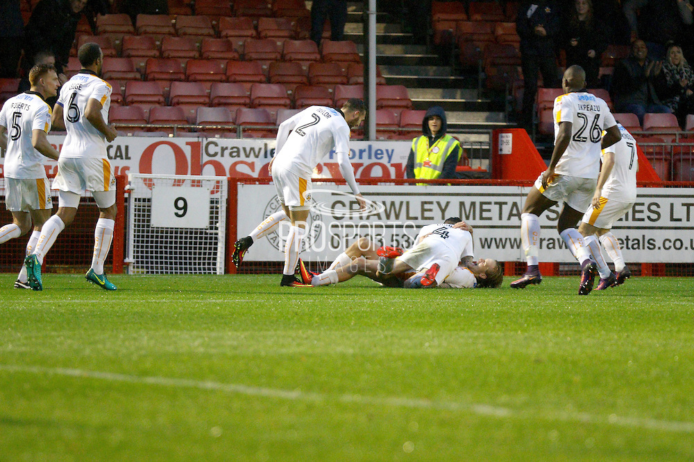 Cambridge United players celebrate a goal from Cambridge United midfielder Luke Berry (8) 3-1  during the EFL Sky Bet League 2 match between Crawley Town and Cambridge United at the Checkatrade.com Stadium, Crawley, England on 12 November 2016. Photo by Andy Walter.