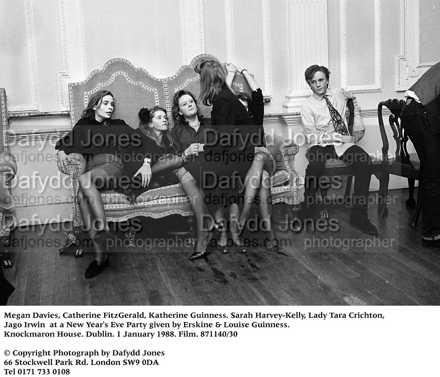 Megan Davies, Catherine FitzGerald, katherine Guinness. Sarah Harvey-Kelly, Lady Tara Crichton, Jago Irwin at a New Year's Eve Party given by Erskine & Louise Guinness. Knockmaron House. Dublin. 1 January 1988. Film. 871140/30<br />