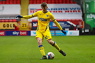 AFC Wimbledon defender Steve Seddon (42) passing the ball during the EFL Sky Bet League 1 match between Charlton Athletic and AFC Wimbledon at The Valley, London, England on 12 December 2020.