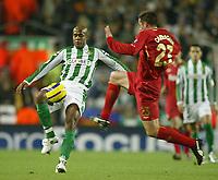 Photo: Aidan Ellis.<br /> Liverpool v Real Betis. UEFA Champions League.<br /> 23/11/2005.<br /> Liverpool's Jamie Carragher challenges Betis Marcos Assuncao