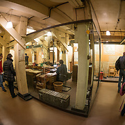 A wide-angle shot of the Map Room at the Churchill War Rooms in London. The museum, one of five branches of the Imerial War Museums, preserves the World War II underground command bunker used by British Prime Minister Winston Churchill. Its cramped quarters were constructed from a converting a storage basement in the Treasury Building in Whitehall, London. Being underground, and under an unusually sturdy building, the Cabinet War Rooms were afforded some protection from the bombs falling above during the Blitz.