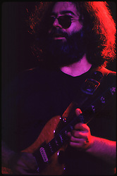 Jerry Garcia looking out over the Audience in Contemplation. The Grateful Dead in Concert at the Huntington Civic Center, Huntington West Virginia on 16 April 1978. Image No. 78C15-07