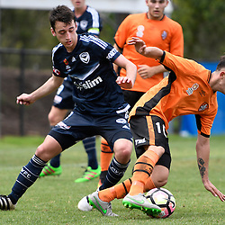 BRISBANE, AUSTRALIA - NOVEMBER 12: Nicholas Panetta of the Roar controls the ball under pressure from Benjamin Carrigan of the Victory during the round 1 Foxtel National Youth League match between the Brisbane Roar and Melbourne Victory at Spencer Park on November 12, 2016 in Brisbane, Australia. (Photo by Patrick Kearney/Brisbane Roar)