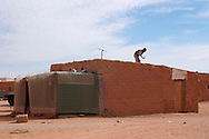 A man works on December 12, 2003, in the Saharawi refugee camps. Saharawi people have been living at the refugee camps of the Algerian desert named Hamada, or desert of the deserts, for more than 30 years now. Saharawi people have suffered the consecuences of European colonialism and the war against occupation by Moroccan forces. Polisario and Moroccan Army are in conflict since 1975 when Hassan II, Moroccan King in 1975, sent more than 250.000 civilians and soldiers to colonize the Western Sahara when Spain left the country. Since 1991 they are in a peace process without any outcome so far. (Ander Gillenea / Bostok Photo)
