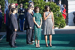 October 18, 2016 - Washington, DC, United States - On the South Lawn  of the White House in Washington, D.C., U.S., on Tuesday, Oct. 18, 2016., (l-r), Mrs. Agnese Landini, and First Lady Michelle Obama, stand at attention during the ceremony at the Official State Visit. This was the last Official State Visit for the Obama administration. (Credit Image: © Cheriss May/NurPhoto via ZUMA Press)