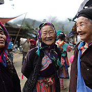 Elderly visitors to the Lung Khau Nhin Market. Vietnam. Lung Khau Nhin Market is rural tribal market hiding itself amongst the mountains and forests of the far north Vietnam about 10 km from the border with China. The market plays an important role for the local ethnic people, Flower Hmong, Black Zao, Zay, and very small ethnic groups  Pa Zi, Tou Zi, Tou Lao. Tourist trips to the market run from Sapa and Lao Cai every week. Lung Khau Nhin Market, Vietnam.15th March 2012. Photo Tim Clayton