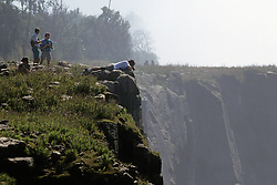 Tourists Photographing Victoria Falls
