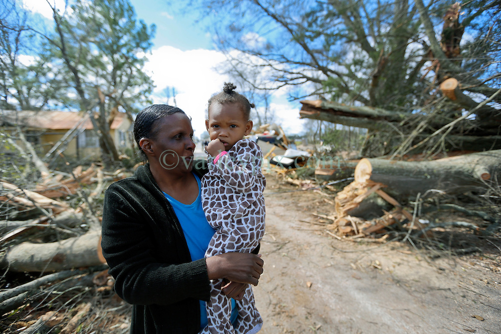 24 February 2016. Water tower Street, Convent, Louisiana.<br /> Devastation following a deadly EF3 tornado touchdown. 2 confirmed dead. <br /> Mary Williams (53 yrs) and granddaughter Leona Washington (2 yrs) survey the damage to their home.<br /> Photo©; Charlie Varley/varleypix.com