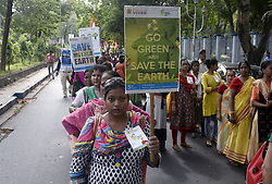 June 5, 2017 - Kolkata, West Bengal, India - Member, activist and student join the rally with poster and placards to create awareness about environment protection. Members of Vivek hold an awareness campaign ''Walk for Environment'' to create awareness for environment among general people on the occasion of World Environment Day in Kolkata. World Environment Day observes annually on June 05 to encouraging worldwide awareness and action for protection of our Environment. (Credit Image: © Saikat Paul/Pacific Press via ZUMA Wire)