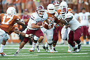 AUSTIN, TX - AUGUST 31: Andrew McDonald #12 of the New Mexico State Aggies scrambles against the Texas Longhorns on August 31, 2013 at Darrell K Royal-Texas Memorial Stadium in Austin, Texas.  (Photo by Cooper Neill/Getty Images) *** Local Caption *** Andrew McDonald