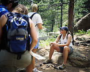 A quick stop to check the trail map while hiking the Seven Bridges trail in the foothills of Colorado Springs, Colorado