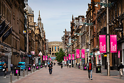 Glasgow, Scotland, UK. 12 June 2020.  Although shops can reopen in England next week, in Scotland the lockdown is not being relaxed so quickly with several more weeks of restrictions to go. Shops and businesses remain closed and streets are very quiet. Pictured; Buchanan Street shopping precinct is very quiet.  Iain Masterton/Alamy Live News
