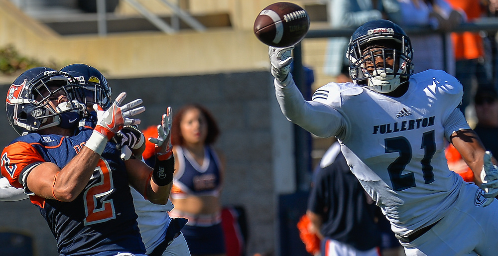 Fullerton Hornet defensive back Deshon Taylor (21) tips the pass preventing Orange Coast Pirate wide receiver Joey Cox (2) reception during the game played in Costa Mesa, California, Saturday, Nov 5, 2016. Photo By: Bryan Woolston, Sports Shooter Academy