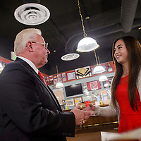 050615       Cable Hoover<br /> <br /> Zuni High School senior Gabrielle Villorente, right, receives the $5000 Senior of the Year scholarship award from Jay McCollum during the Rotary Club luncheon at Sammy C's Pub in Gallup Wednesday. Villorente was selected for the award based on an essay, interview and recommendation from her school. The Rotary Club awarded $24,000 worth of scholarships during the luncheon but the Senior of the Year was the largest.