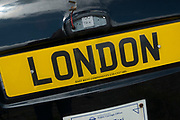 London black taxi cab artwork sculpture with the number plate London in London, England, United Kingdom. (photo by Mike Kemp/In Pictures via Getty Images)