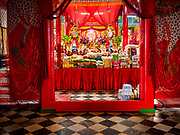 13 JULY 2017 - BANGKOK, THAILAND: Interior of Chao Mae Thapthim Shrine in the Dusit district of Bangkok. The Chinese shrine is at the foot of Krung Thon Bridge and serves poor communities along the Chao Phraya River. The shrine is along a part of the riverfront the government wants to tear down to build an esplanade. The future of the shrine itself is unknown, but many of the communities around it could be evicted and razed.      PHOTO BY JACK KURTZ
