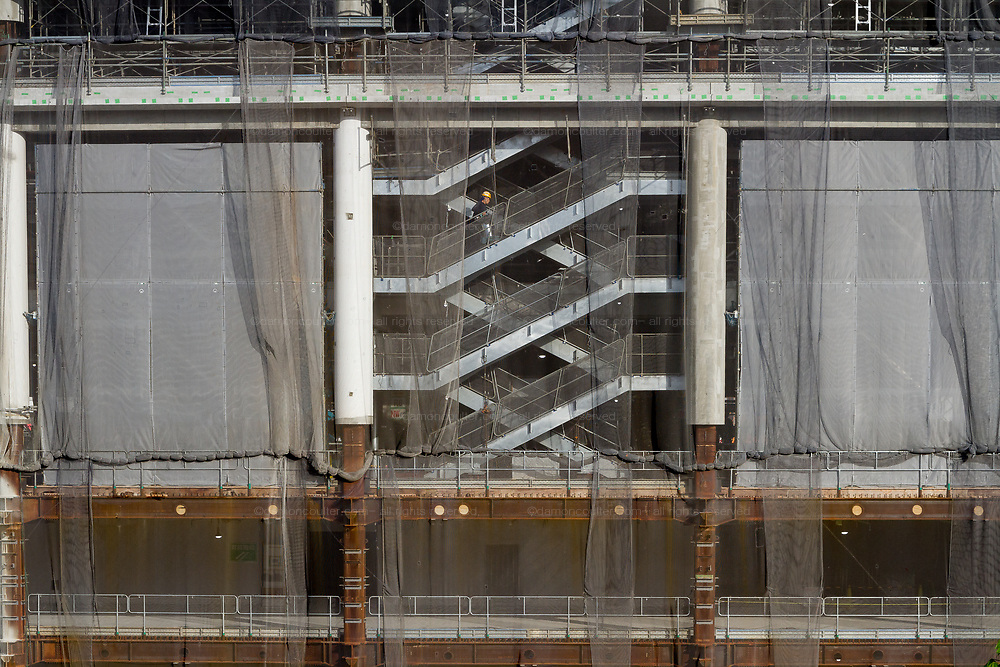 A workman climbs some stairs in the construction site of new National Stadium as preparations for the 2020 Tokyo Olympics continue in Gaiemmae, Tokyo, Japan. Friday May 25th 2018