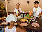 "04 APRIL 2015 - CHIANG MAI, CHIANG MAI, THAILAND:  Boys being ordained as Buddhist novices eat their lunch at the Poi Sang Long Festival at Wat Pa Pao in Chiang Mai. The Poi Sang Long Festival (also called Poy Sang Long) is an ordination ceremony for Tai (also and commonly called Shan, though they prefer Tai) boys in the Shan State of Myanmar (Burma) and in Shan communities in western Thailand. Most Tai boys go into the monastery as novice monks at some point between the ages of seven and fourteen. This year seven boys were ordained at the Poi Sang Long ceremony at Wat Pa Pao in Chiang Mai. Poy Song Long is Tai (Shan) for ""Festival of the Jewel (or Crystal) Sons.     PHOTO BY JACK KURTZ"