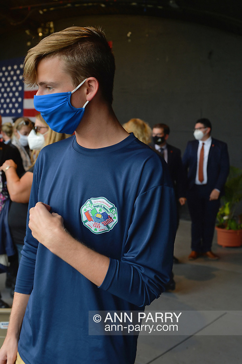 East Meadow, New York, U.S. September 10, 2020. JOEY LABO, 16, of Wantagh, wears a shirt in memory of his uncle Joseph G. Hunter, a FDNY 288 firefighter who died during the attacks, 9/11/01. Nassau County commemorated 19th anniversary of September 11 terrorist attacks with Remembrance Ceremony at Eisenhower Park. Due to COVID-19 concerns, all wore masks when social distancing wasn't possible. Event was held at Harry Chapin Lakeside Theater, instead of 9/11 Memorial across the pond, because of rain prediction.