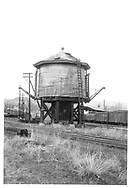 A southwest-looking view of the D&RGW Durango water tank showing two water spouts.  The second installed as a movie prop.<br /> D&RGW  Durango, CO  <br /> Same image as RD001-024.