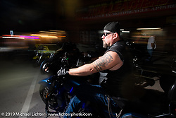 Riding Main Street at night during the Sturgis Motorcycle Rally. Sturgis, SD, USA. Wednesday, August 11, 2021. Photography ©2021 Michael Lichter.