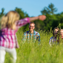 A young family plays in a field in Epping, New Hampshire.