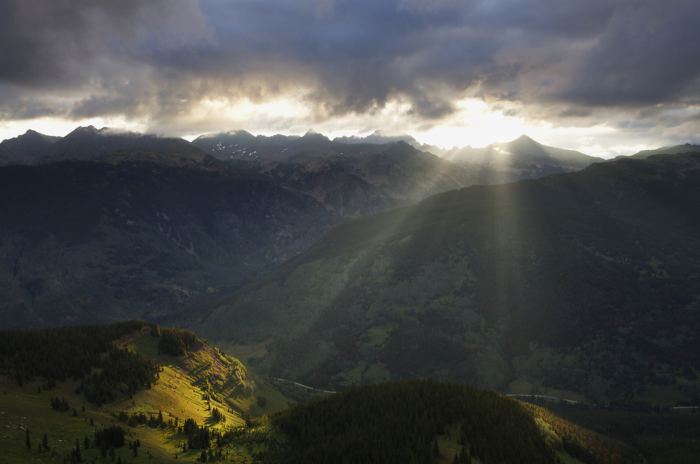 CREPUSCULAR RAYS OVER THE GORE RANGE AT SUNRISE, WHITE RIVER NF, COLORADO