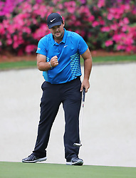 April 7, 2018 - Augusta, GA, USA - Patrick Reed birdies the 13th hole during the third round of the Masters Tournament on Saturday, April 7, 2018, at Augusta National Golf Club in Augusta, Ga. (Credit Image: © Curtis Compton/TNS via ZUMA Wire)