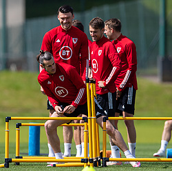 CARDIFF, WALES - Friday, June 4, 2021: Wales' (L-R) captain Gareth Bale, Kieffer Moore and Aaron Ramsey during a training session at the Vale Resort ahead of an International Friendly against Albania as they prepare for the UEFA Euro 2020 tournament. (Pic by David Rawcliffe/Propaganda)