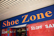 Sign for the brand and budget shoe shop Shoe Zone in Birmingham, United Kingdom.