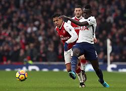 Arsenal's Alexis Sanchez (left) and Tottenham Hotspur's Davinson Sanchez battle for the ball during the Premier League match at the Emirates Stadium, London.