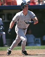 New York Yankee Tino Martinez drives a homerun to right field against the Kansas City Royals at Kauffman Stadium in Kansas City, Missouri on May 4, 1997.