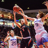 Gallup Bengal Ashley Antone (1), center, grabs a rebound from Bloomfield Bobcat Mattie Waresback (5) during a District 5A semifinal at The Pit in Albuquerque Thursday.  The Bengals fell to the Bobcats 59-56.