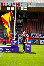 31JUL21 Unfurling the div one flag. Partick Thistle 3 v 2 Queen of the South. First Scottish Championship game of the season.