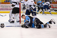 19 February, 2006 - Anchorage, AK:  After being hit by Long Beach's Mac Faulkner (21), which took his helmet off of him, Aces Peter Metcalf (4) looks up for the referee and asks where was the penalty.  The Alaska Aces would take a overtime victory, 3-2 against the visiting Long Beach IceDogs at the Sullivan Arena.