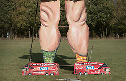 © Licensed to London News Pictures. 31/10/2018. Edenbridge, UK. Two EU referendum buses are seen at the feet of an effigy of former foreign secretary Boris Johnson as it is unveiled in Edenbridge, Kent ahead of its burning at the town's bonfire this Saturday. The 10 meter high figure stands over two EU referendum buses and Boris is also carrying an EU cake. Photo credit: Peter Macdiarmid/LNP