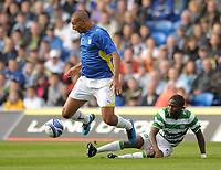 Jay Bothroyd of Cardiff City is tackled by Landry N'Guémo of Celtic<br /> Cardiff City vs Celtic<br /> Pre-season friendly, Cardiff City Stadium, Cardiff, Wales, UK<br /> 22/07/2009. Credit Colorsport/Dan Rowley