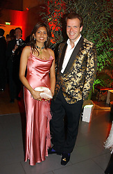 JOL CADBURY and VIMLA LALVANI at Andy & Patti Wong's Chinese New Year party to celebrate the year of the Rooster held at the Great Eastern Hotel, Liverpool Street, London on 29th January 2005.  Guests were invited to dress in 1920's Shanghai fashion.<br />