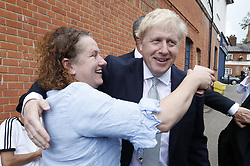 © Licensed to London News Pictures. 25/06/2019. Oxshott, UK. Conservative leadership candidate Boris Johnson receives a hug from local resident Eva Kennedy as he campaigns in Oxshott, Surrey. Mr Johnson is campaigning in various locations in the south east of England today. Photo credit: Peter Macdiarmid/LNP