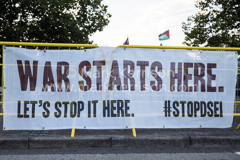 A Stop DSEI banner is pictured during Stop The Arms Fair protests outside ExCeL London as preparations for the DSEI 2021 arms fair continue on 8th September 2021 in London, United Kingdom. The third day of week-long Stop The Arms Fair protests outside the venue for one of the world's largest arms fairs was themed around demilitarising education.