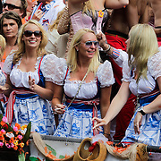 NLD/Amsterdam/20120804 - Canalparade tijdens de Gaypride 2012, meisjes in Delfts blauwe jurkjes