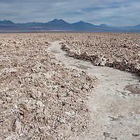The largest salt flat of Chile is located in the middle of the Atacama desert. The climate is extremely dry and you can feel the low humidity which lies around 3%-15% on your skin. But these climate conditions are perfect for photography as the air is very clear.