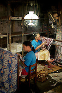 These women are making traditional batik clothing in a factory in Solokarta, Indonesia.
