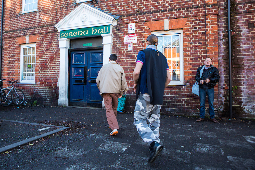 Men arriving at the centre of Slough Homeless our concern (SHOC) A local homeless charity helping the homeless and vulnerable in Slough. Berkshire, UK.