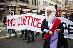 © licensed to London News Pictures. London, UK 05/10/2013. UK Uncut demonstrators protesting against cuts to legal aid as they march from the Old Bailey to the Royal Courts of Justice in central London on Saturday, 5 October 2013. Photo credit: Tolga Akmen/LNP