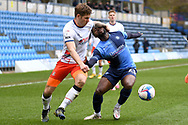 Wycombe Wanderers midfielder Fred Onyedinma (23) battles for possession  with Luton Town forward James Collins (19) during the EFL Sky Bet Championship match between Wycombe Wanderers and Luton Town at Adams Park, High Wycombe, England on 10 April 2021.